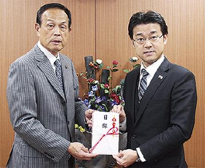 (株)永田屋が60万円寄付