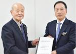 久保田会長(左)と星野常務