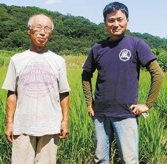 """現在、大島にある依田賢吾(写真右)さんの水田で酒米""""山田錦""""作りに励んでいる。写真左は中心となって構想を進める石井好一さん"""