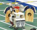 丁寧にハンガーを掛けるロボット