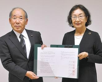 町田市社協の小野会長(左)と多摩市社協の伊藤雅子会長
