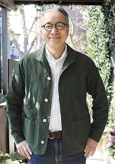 グリーンのウェアを着用する吉田さん