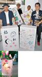 【上】絵灯篭の準備をする千人町1丁目町会の会員。左端が飯田会長。右端が森上さん/【下】昨年の様子