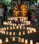 """大和青年会議所が今年10月23日に大和駅東側プロムナードで開催した「第4回ほっと・ナイト・やまと2011〜""""絆""""で繋げようOMOIYARIのこころ〜」 =写真提供・大和青年会議所"""