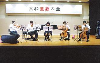 演奏を行う石川ファミリーアンサンブル