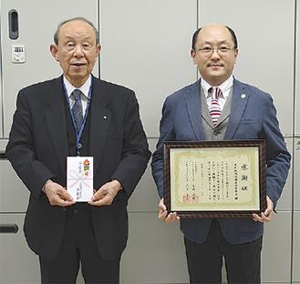 栗城会長(右)と高橋会長