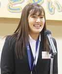 アジア大会の報告をする田中選手
