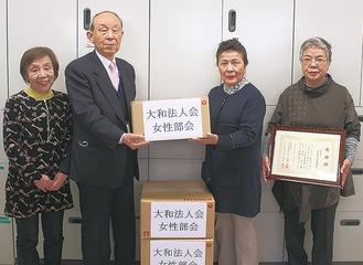 (写真左から)梅田安代会計幹事、高橋社協会長、政森美津江監事、天野正恵副部会長