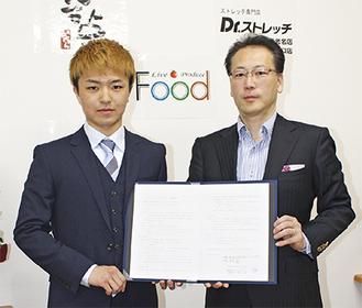 小林代表(右)と西京選手(左)