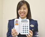 電話の受話器に張り付ける