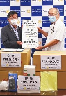 溝渕会長(左)と高原理事長
