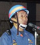 講評する田中団長