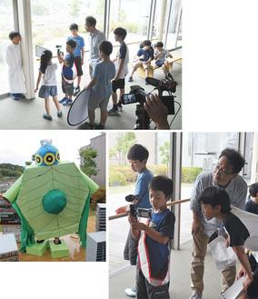 (写真上)撮影風景(写真右下)小中和哉監督と相談しながらカメラを覗きこむ日高瞬希さん(写真左下)児童が作った怪獣