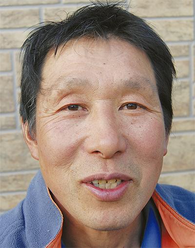市川 芳明さん