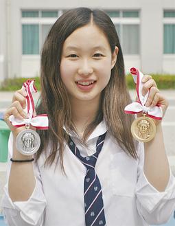 「初めてのメダルは重いです」