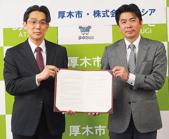 協定締結に市役所を訪れた(株)プレシア専務取締役・滝口勝寿さんと前島亨さん