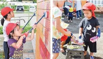 園舎の壁に色を塗る園児ら