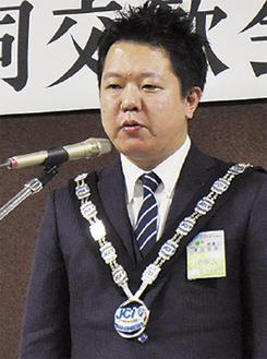 所信表明する津田理事長