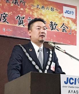 所信表明する齊藤理事長
