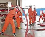 町消防では職員と同じ制服で作業