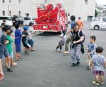 救助工作車と綱引き