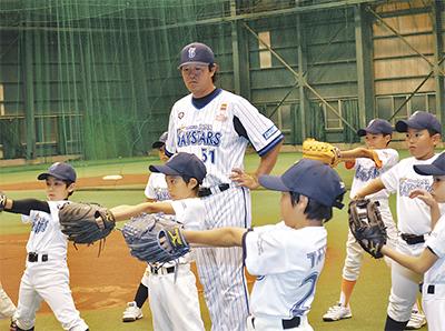 野球少年に熱血指導
