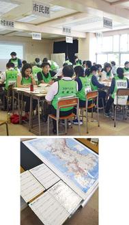 部局ごとに分かれて訓練する市職員(写真上)、地図や表で情報を一元化(同下)