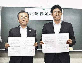 相原厚志理事長(左)、小澤一成代表取締役社長