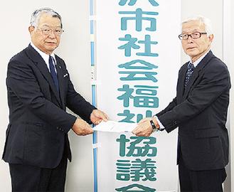 安西会長(左)と加藤会長