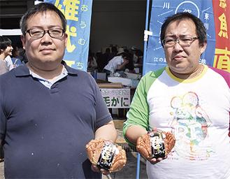 兄の榎本正彦さん(左)と弟の幸彦さん
