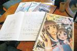 店内にある「聖地巡礼ノート」。アニメファンからのメッセージがびっしりと書き込まれており、海外からの訪問客も。今年5冊目に入った