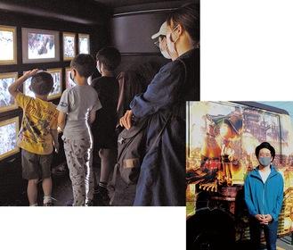 上・光る絵の展示を楽しむ親子連れ。「絵がかわいくて面白かった」(小2)。右・バスを誘致した落合さん