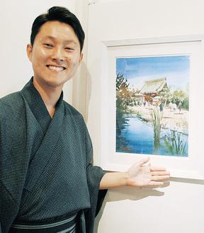 独特なタッチで描いた長谷寺の作品を紹介する矢野さん