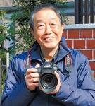 カメラを構える高橋さん