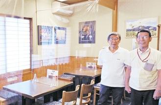 古屋嘉廣さん(右)とフォトクラブ・ベアーズの浅利篤さん
