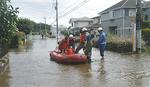 岡田8丁目の住宅街ではボートでの救出シーンも