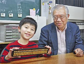 大会を振り返る太田君(左)と大貝代表