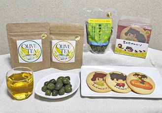 左からオリーブ茶(生葉と乾燥葉)、湘南オリーブ二宮産新漬オリーブ、菜の花畑のにーのみーやクッキー