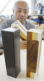 現在の標柱(左)、試作品(右)を作った露木さん