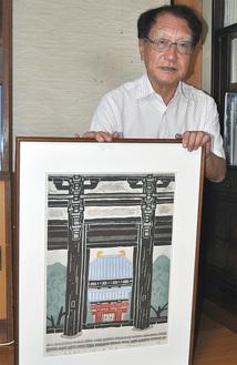 作品「東大寺」を持つ石渡武夫さん