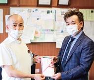 足柄上病院に100万円