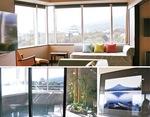 小田原城を望むデラックスツインルームと男性用露天風呂。客室には富士山の写真が飾られている