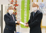 内藤理事長(左)と小野会長