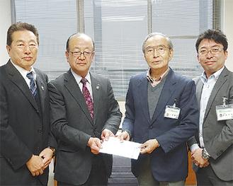 安藤専務(中央左)と小沢会長(中央右)