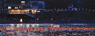 船で曳かれ岩海岸に並んだ灯篭