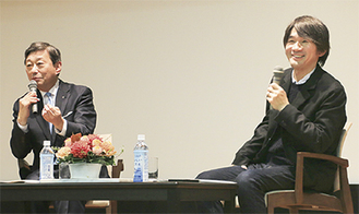 基調対談をする指出編集長(右)と山田学長
